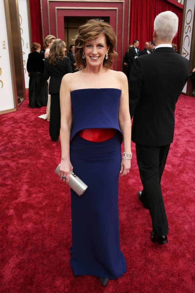 Anne Sweeney, Co-Chair of Disney Media and President of the DisneyABC Television Group, arrives at the Oscars on Sunday, March 2, 2014, at the Dolby Theatre in Los Angeles.  (Photo by Matt Sayles/Invision/AP)
