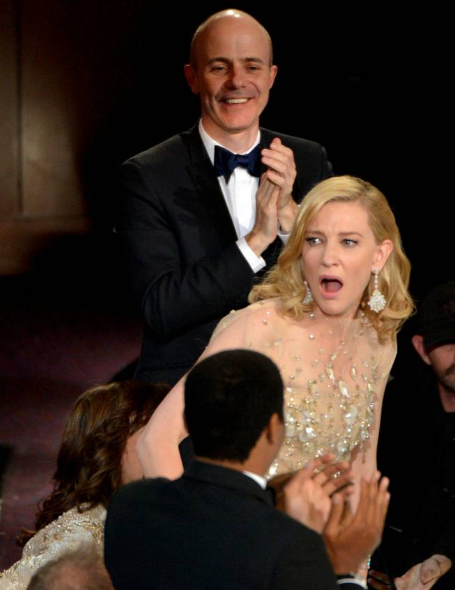 "Cate Blanchett reacts after winning the award for best actress in a leading role for ""Blue Jasmine"" during the Oscars at the Dolby Theatre on Sunday, March 2, 2014, in Los Angeles.  (Photo by John Shearer/Invision/AP)"