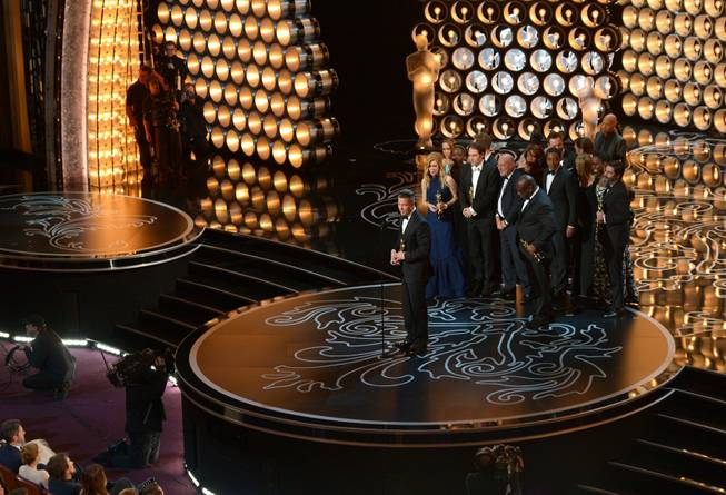 "Brad Pitt and the cast and crew of ""12 Years a Slave"" accept the award for the best picture of the year during the Oscars at the Dolby Theatre on Sunday, March 2, 2014, in Los Angeles."