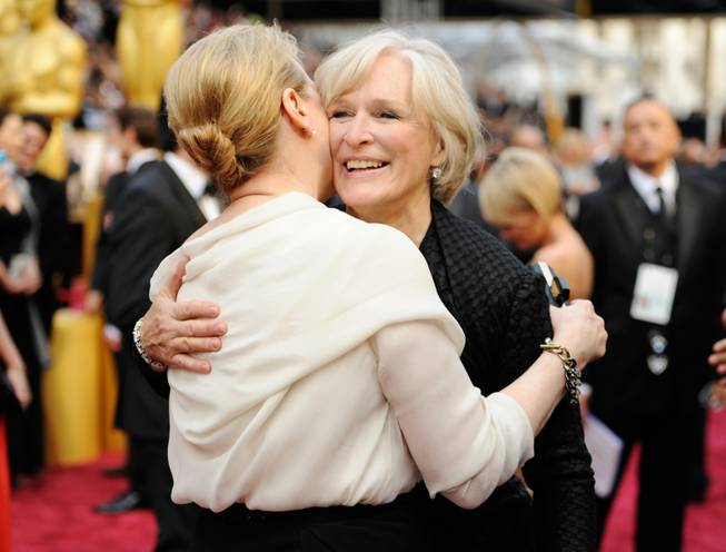Meryl Streep, left, and Glenn Close arrive at the Oscars on Sunday, March 2, 2014, at the Dolby Theatre in Los Angeles.  (Photo by Chris Pizzello/Invision/AP)