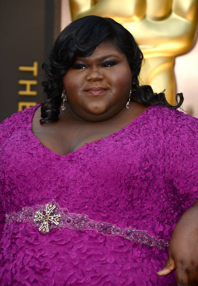 Gabourey Sidibe arrives at the Oscars on Sunday, March 2, 2014, at the Dolby Theatre in Los Angeles.  (Photo by Jordan Strauss/Invision/AP)