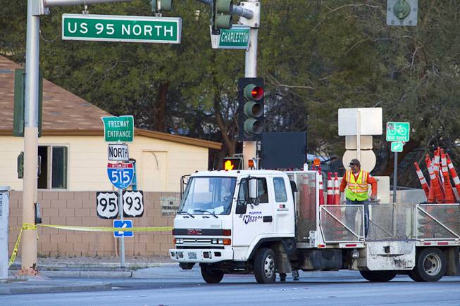 An Nevada of Transportation truck drops off traffic cones near the scene of an officer-involved shooting by Charleston Boulevard and Highway 95 Monday, March 3, 2014.