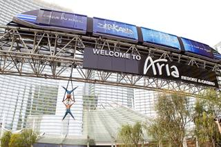 "British twin brothers Andrew and Kevin Atherton, Cirque du Soleil aerialists with ""Zarkana,"" perform under the monorail truss in Aria's porte cochere Monday, March 3, 2014. The performance was promoting ""Zarkana's"" reimagined show, which includes a new soundtrack and a new aerial straps act."