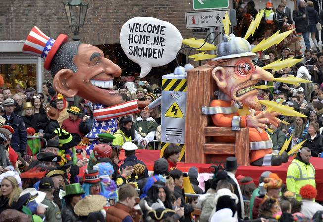 A carnival float depicting US president Barack Obama, left,  putting whistleblower Edward Snowden on an electric chair during the traditional carnival parade in Duesseldorf, western Germany, on Monday, March 3, 2014. The foolish street spectacles in the carnival centers of Duesseldorf, Mainz and Cologne, watched by hundreds of thousands of people, are the highlights in Germany's carnival season on Rose Monday.