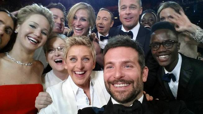 This image released by Ellen DeGeneres shows actors front row from left, Jared Leto, Jennifer Lawrence, Meryl Streep, Ellen DeGeneres, Bradley Cooper, Peter Nyong'o Jr., and, second row, from left, Channing Tatum, Julia Roberts, Kevin Spacey, Brad Pitt, Lupita Nyong'o and Angelina Jolie as they pose for a selfie on a cell phone during the Oscars at the Dolby Theater on Sunday, March 2, 2014, in Los Angeles.