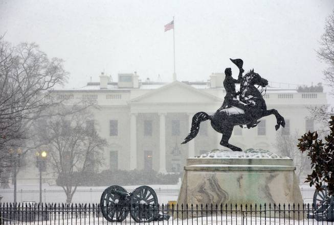 The statue of President Andrew Jackson at the Battle of New Orleans, sculpted in 1853 by Clark Mill sits in the falling snow in Lafayette Park across the street from the White House in Washington, Monday, March 3, 2014. The winter weather prompted area schools and the federal government to close and the National Weather Service has issued a Winter Storm Warning for the greater Washington Metropolitan region.