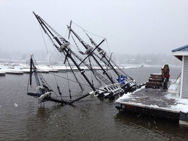 A 43-foot pirate ship tour boat is shown partially submerged in Big Bear Lake, Calif., on Saturday, March 1, 2014. The 27-ton boat had been docked at Holloway Marina before sinking.