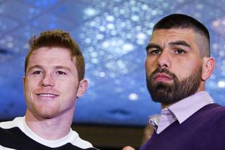 Light middleweight boxers Canelo Alvarez, left, and Alfredo Angulo, both of Mexico, pose in the lobby of the MGM Grand during arrivals Tuesday, March 4, 2014. The fighters will meet for a non-title, 12-round fight at the MGM Grand Garden Arena on Saturday.