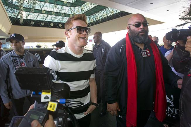 Light middleweight boxer Canelo Alvarez, center, of Mexico, arrives at the MGM Grand Tuesday, March 4, 2014. Alvarez will face Alfredo Angulo, also of Mexico, in a non-title, 12-round fight at the MGM Grand Garden Arena on Saturday.