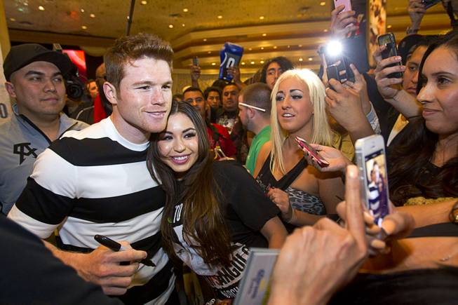 Light middleweight boxer Canelo Alvarez of Mexico poses with a fan in the MGM Grand lobby Tuesday, March 4, 2014. Alvarez will face Alfredo Angulo, also of Mexico, in a non-title, 12-round fight at the MGM Grand Garden Arena on Saturday.
