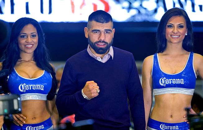 Light middleweight boxers Alfredo Angulo of Mexico poses with Corona Girls in the MGM Grand lobby Tuesday, March 4, 2014. Angulo will take on Canelo Alvarez, also of Mexico, in a non-title, 12-round fight at the MGM Grand Garden Arena on Saturday.