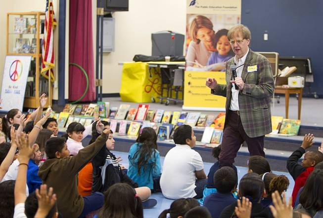 Comedy-magician Mac King looks for volunteers to help him with a trick as he kicks off his Magical Literacy Tour: Nevada Reading Week 2014 with students at Vegas Verdes Elementary School Tuesday, March 4, 2014. For the fourth year, the Harrahs headliner will visit schools to perform magic tricks, talk about the importance of reading and distribute books collected during book drives.