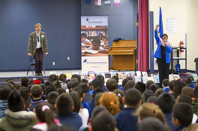 Beverly Mathis, right, director of early learning for the Public Education Foundation, and Comedy-magician Mac King kick off King's Magical Literacy Tour: Nevada Reading Week 2014 with students at Vegas Verdes Elementary School Tuesday, March 4, 2014. For the fourth year, the Harrahs headliner will visit schools to perform magic tricks, talk about the importance of reading and distribute books collected during book drives.