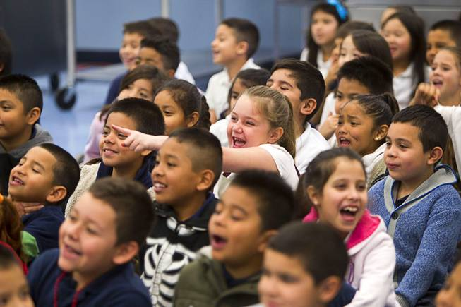 Students react to comedy-magician as Mac King appears to eat an earthworm during his Magical Literacy Tour: Nevada Reading Week 2014 with students at Vegas Verdes Elementary School Tuesday, March 4, 2014. For the fourth year, the Harrahs headliner will visit schools to perform magic tricks, talk about the importance of reading and distribute books collected during book drives.
