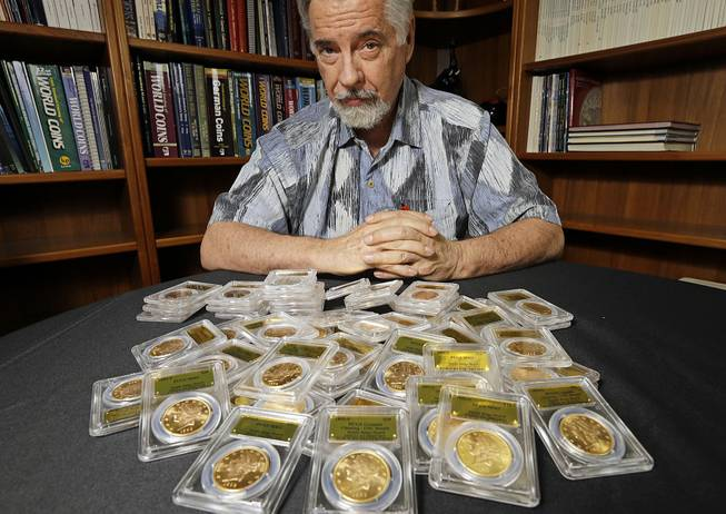 David Hall, co-founder of Professional Coin Grading Service, with some of the 1,427 Gold Rush-era U.S. gold coins at his office in Santa Ana, Calif., on Tuesday, Feb. 25, 2014.