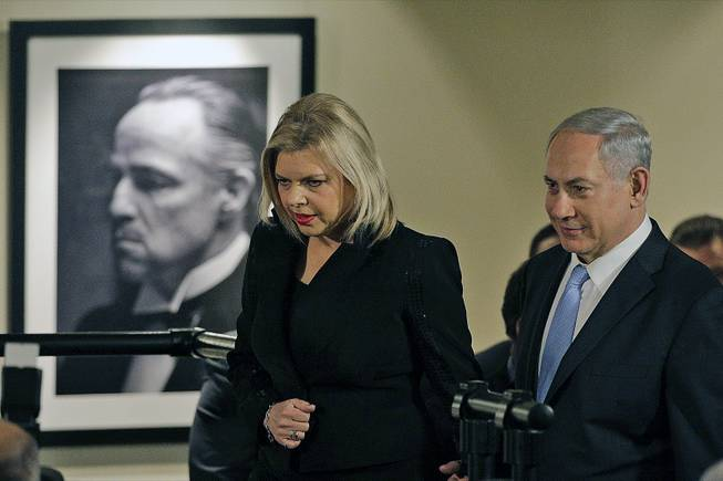 "Israeli Prime Minister Benjamin Netanyahu, right, and his wife, Sara, arrive for the screening of the television documentary ""Israel: The Royal Tour"" at Paramount Studios on Tuesday, March 4, 2014, in Los Angeles."