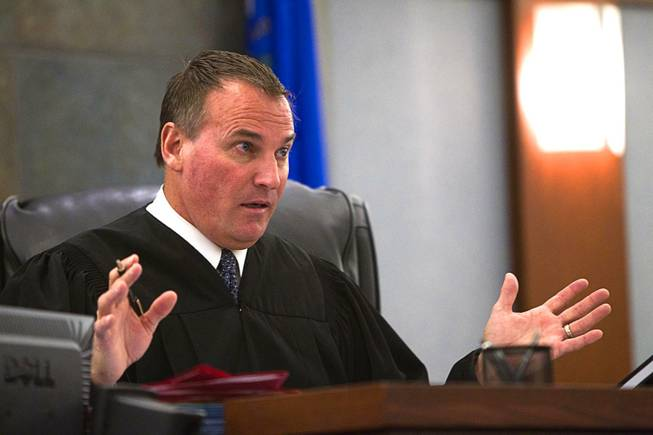 "Judge William ""Bill"" Kephart  questions defense attorney Abel Yanez during in court at the Regional Justice Center Wednesday, March 5, 2014. Yanez is representing former Metro Police Officer Peter Connell. Connell is facing charges of soliciting prostitution."