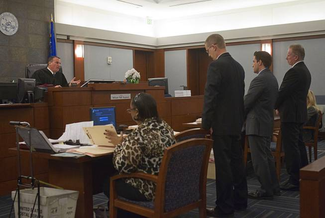 "Judge William ""Bill"" Kephart  questions attorneys as former Metro Police Officer Peter Connell, far right, appears in court at the Regional Justice Center Wednesday, March 5, 2014. Connell is facing charges of soliciting prostitution. Attorneys are Mark Schifalacqua, standing left, and Abel Yanez."