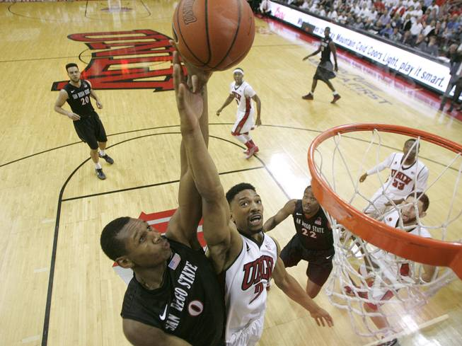 UNLV forward Khem Birch defends a shot by San Diego State forward Skylar Spencer during their Mountain West Conference game Wednesday, March 5, 2014 at the Thomas & Mack Center.
