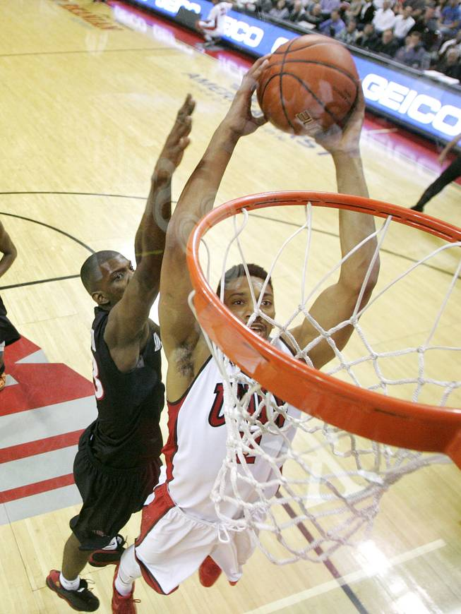 UNLV forward Khem Birch leaps in for a dunk against San Diego State during their Mountain West Conference game Wednesday, March 5, 2014 at the Thomas & Mack Center. The Aztecs won 73-64.