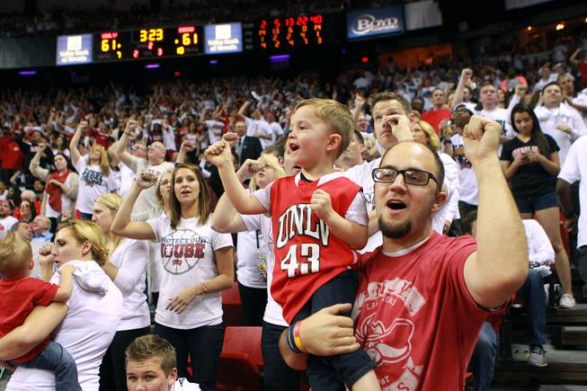 UNLV fans Patrick Amico and his son Trey Amico cheer late in their game against San Diego State Wednesday, March 5, 2014 at the Thomas & Mack Center. The Aztecs won 73-64.