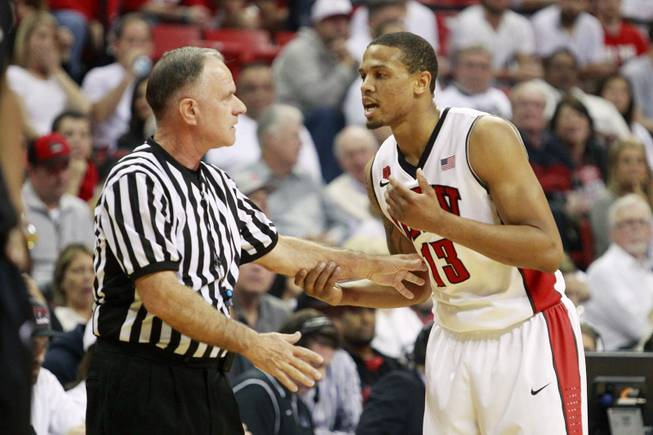 UNLV guard Bryce Dejean Jones complains to official Dick Cartmell after he was hit in the head by a San Diego State player during their Mountain West Conference game Wednesday, March 5, 2014, at the Thomas & Mack Center. The Aztecs won 73-64.