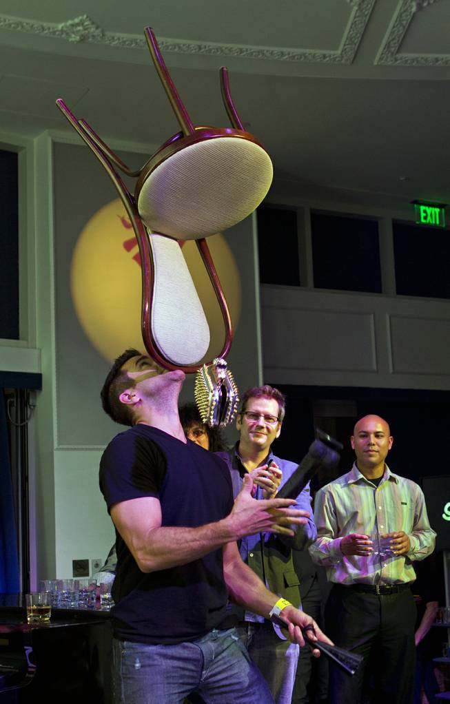 Juggler Jeff Civillico balances a chair on his chin and juggles during Las Vegas Weekly's Unscripted Party featuring Stifler in the Havana Room on Tuesday, March 4, 2014, at the Tropicana.