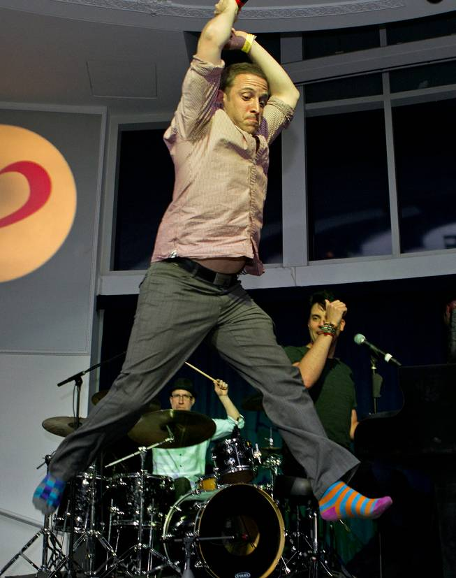 Martin Kaye leaps during his big finish at Las Vegas Weekly's Unscripted Party featuring Stifler in the Havana Room on Tuesday, March 4, 2014, at the Tropicana.