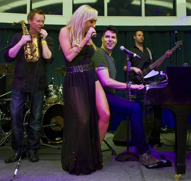 Lorena Peril is accompanied by Frankie Moreno during Las Vegas Weekly's Unscripted Party featuring Stifler in the Havana Room on Tuesday, March 4, 2014, at the Tropicana.