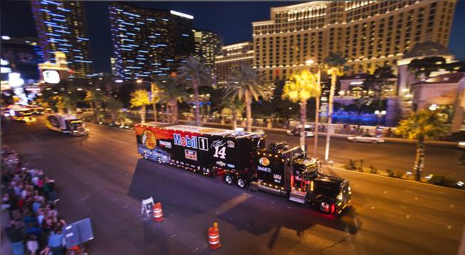 Driver Tony Stewart's NASCAR Hauler is one of many moving up the Las Vegas Strip in celebration for the upcoming Kobalt 400 on Wednesday, March 05, 2014.