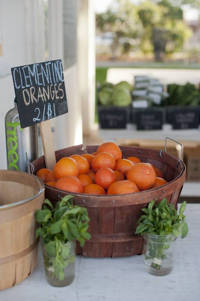 Clementine oranges for sale at Agritopia's Farm Stand market, the community's hub, in Gilbert, Ariz., March 5, 2014. A growing number of residential developments, known as agrihoods, are designed around a working farm instead of a golf course or clubhouse.