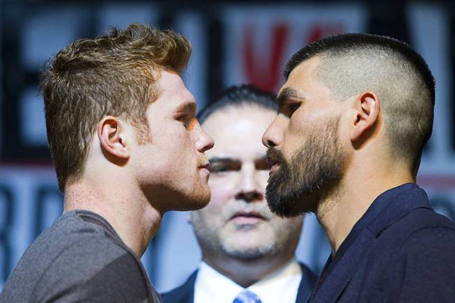 Super-welterweight boxers Canelo Alvarez and Alfredo Angulo face off during a news conference Thursday, March 6, 2014, at MGM Grand. Richard Schaefer, CEO of Golden Boy Promotions, is at center. Alvarez and Angulo, both of Mexico, will fight at MGM Grand Garden Arena on Saturday. Alvarez is a former WBC and WBA 154-pound champion.