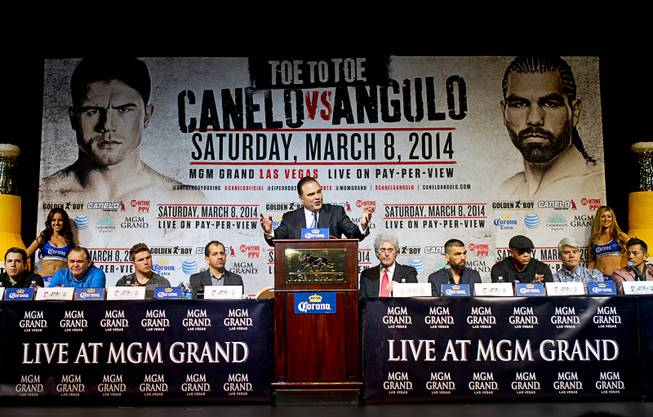 Richard Schaefer, center, CEO of Golden Boy Promotions, speaks during a news conference at the MGM Grand Thursday, March 6, 2014. Canelo Alvarez and Alfredo Angulo, both of Mexico, will fight at the MGM Grand Garden Arena on Saturday.