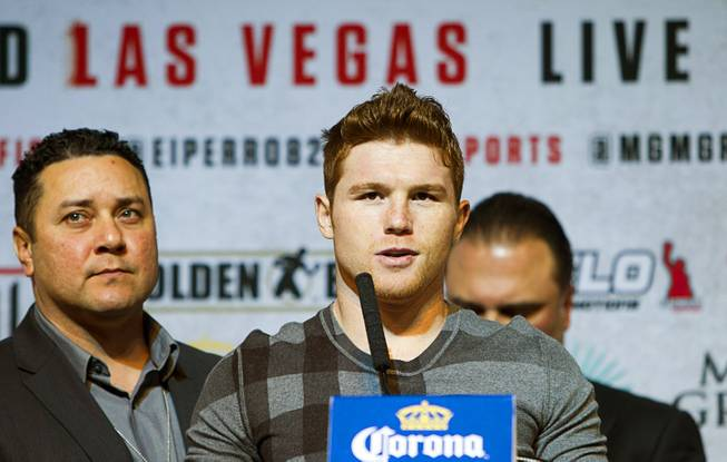 Super welterweight boxer Canelo Alvarez, center, speaks during a news conference at the MGM Grand Thursday, March 6, 2014. Alvarez and Alfredo Angulo, both of Mexico, will fight at the MGM Grand Garden Arena on Saturday. Alvarez is a former WBC and WBA 154 lb. champion.