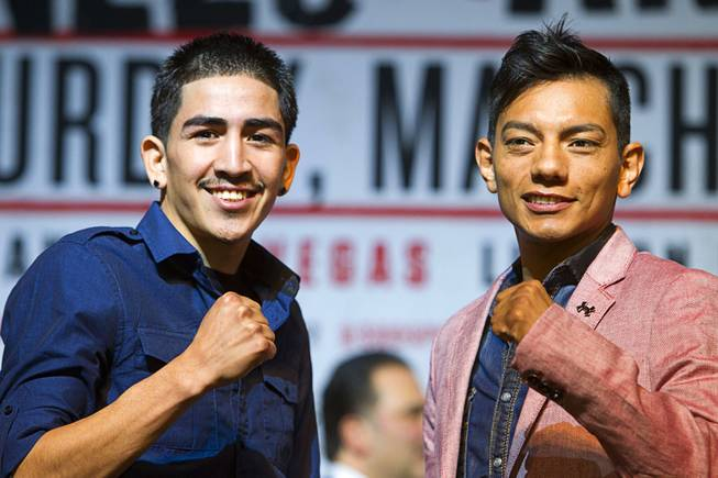 WBC super bantam weight champion Leo Santa Cruz, left, of Mexico and Cristian Mijares, also of Mexico, pose during a news conference at the MGM Grand Thursday, March 6, 2014.  Santa Cruz will defend his title against Mijares at the MGM Grand Garden Arena on Saturday.