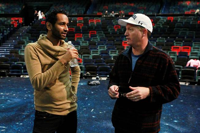 "Creative director Mukhtar O.S. Mukhtar talks with acrobatic coach Dan Niehaus during rehearsals for the upcoming Cirque du Soleil benefit ""One Night 