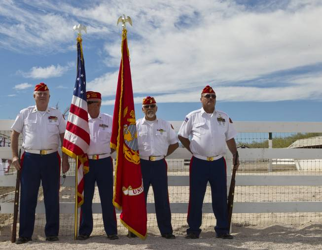 A Marine Corps Honor Guard (RET) readies for the presentation of colors during the Horses4Heroes ribbon cutting grand opening event at Tule Springs on Thursday, March 06, 2014.