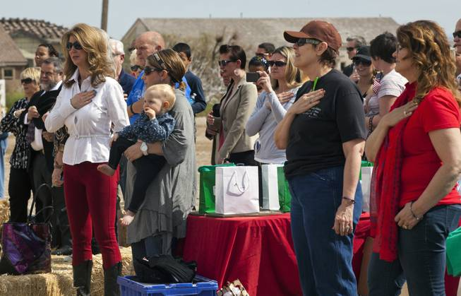 The Pledge of Allegiance begins during the Horses4Heroes ribbon-cutting ceremony and grand-opening at Tule Springs on Thursday, March 06, 2014.