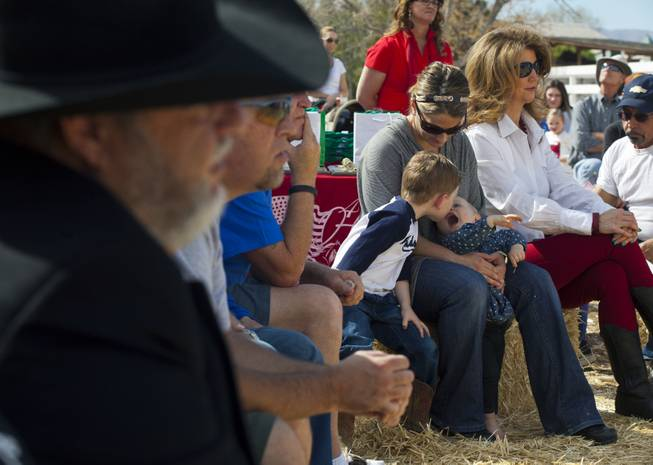Attendees listen to speakers during a Horses4Heroes ribbon-cutting ceremony and grand-opening event at Tule Springs on Thursday, March 06, 2014.