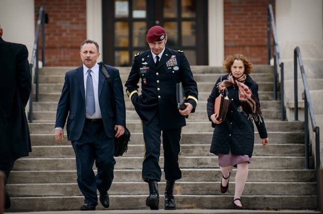 Brig. Gen. Jeffrey Sinclair leaves the courthouse with his lawyers Richard Scheff, left, and Ellen C. Brotman, following a day of motions Tuesday, March 4, 2014, at Fort Bragg, N.C.