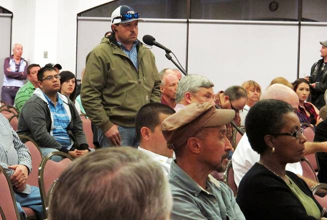 A member of the community speaks of the Feb. 14, 2014 radiation leak during a community meeting in Carlsbad, N.M., Feb. 24, 2014.
