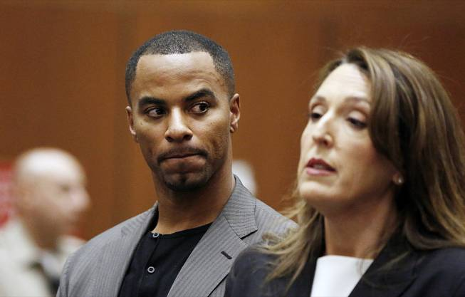 Former NFL safety Darren Sharper looks toward his attorney Blair Berk during an appearance in Los Angeles Superior Court in Los Angeles, where he pleaded not guilty Thursday, Feb. 20, 2014, to charges of drugging and raping two women.