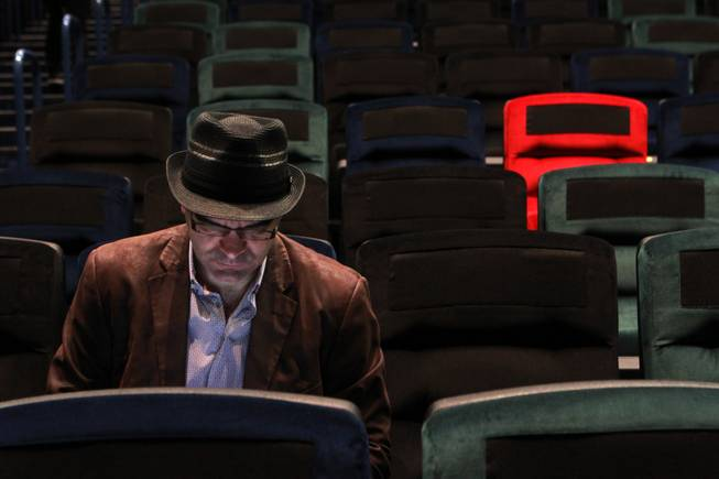 "Greenspun Media Group columnist and writer John Katsilometes takes notes during a rehearsal for the Cirque du Soleil benefit ""One Night 