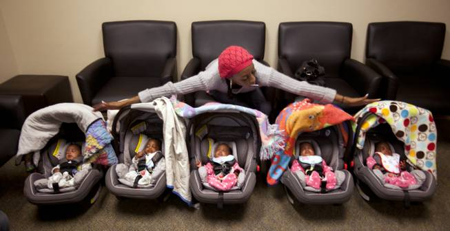"Evonne Derrico shows off her quintuplets as they await their eye doctor appointments. ""You've won 18 years of responsibility,"" she jokes to her husband. ""Two boys and three girls."""
