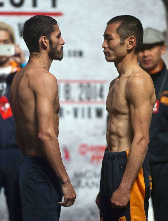 Lightweights Jorge Linares of Venezuela and Nihito Arakawa of Japan  face off following their weigh-ins at the MGM Grand Arena on Friday, March 07, 2014.