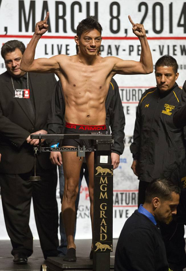 WBC Super Bantamweight Cristian Mijares of Mexico poses for the crowd while on the scale during his weigh-in at the MGM Grand Arena on Friday, March 07, 2014.