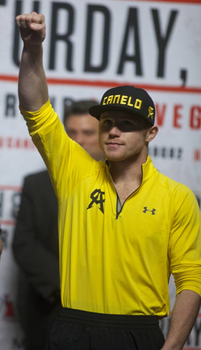 Super welterweight Canelo Alvarez of Mexico greets the fans as he steps up on stage at the MGM Grand Arena on Friday, March 07, 2014.