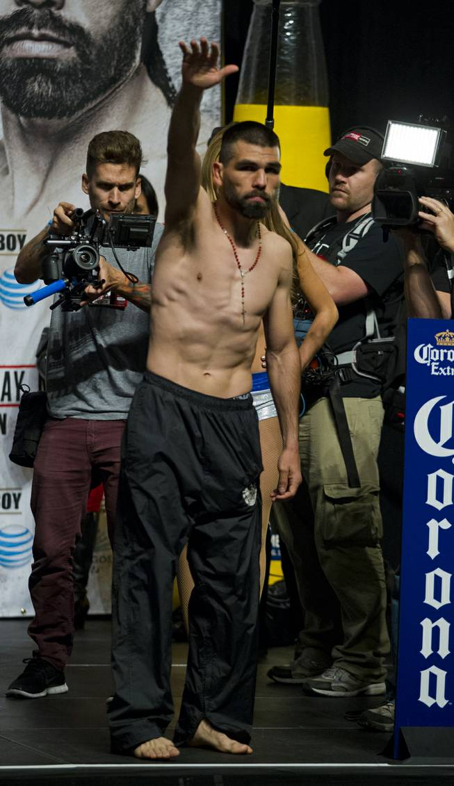 "Super welterweight Alfredo ""El Perro"" Angulo of Mexico waves to the crowd following his weigh-in at the MGM Grand Arena on Friday, March 07, 2014."