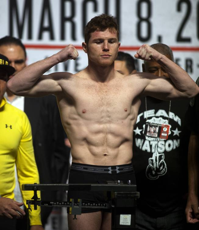 Super welterweight Canelo Alvarez of Mexico flexes during his weigh-in at the MGM Grand Arena on Friday, March 07, 2014.