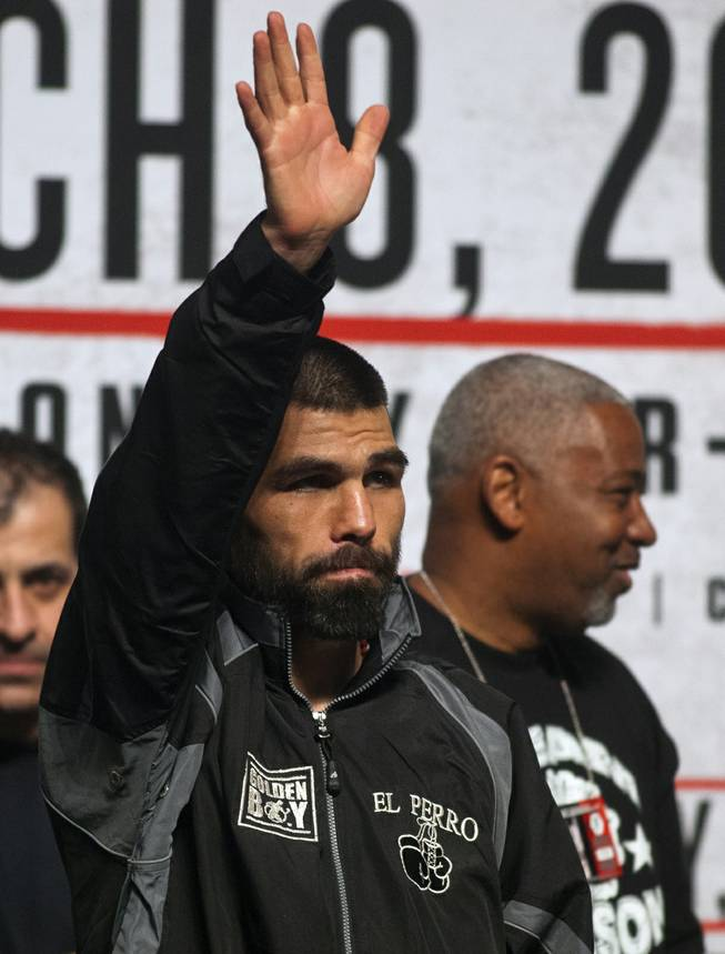 "Alfredo ""El Perro"" Angulo greets the fans as he steps up on stage at the MGM Grand Arena on Friday, March 07, 2014.  L.E. Baskow"